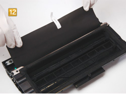 Samsung ML-2250 D5, D8 ELS - Schutzpapier entfernen