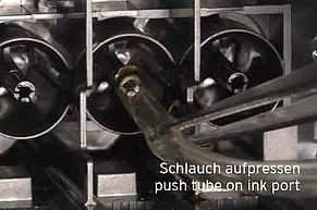 Push plastic hose on ink port for flushing print head