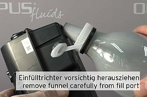 Remove funnel from fill port carefully