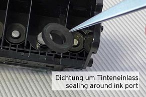[Translate to Englisch:] Dichtung um Tinteneinlass im Canon Druckkopf