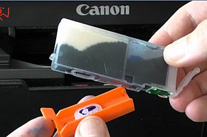 Remove orange cap from ink port