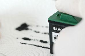 [Translate to Englisch:] Tinte in den Druckkopf befördern